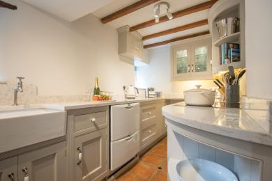 Galley kitchen with hob, drawer dishwasher, combination oven larder fridge and freezer.