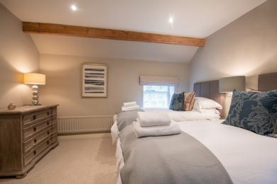 Bedroom 3 with twin or super king size beds, chest of drawers and garment hanging rail.