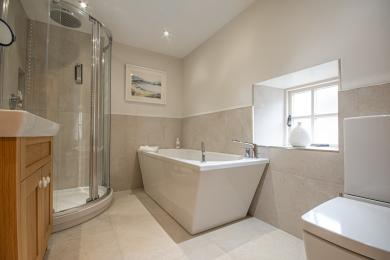 Family Bathroom with separate shower, bath, vanity basin and toilet.