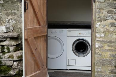 Laundry outbuilding with a washer and dryer.