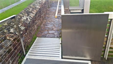 A photograph of the outside ramp leading onto the Roman Wall.