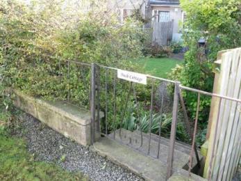 Back gate, 5 steps down into garden.
