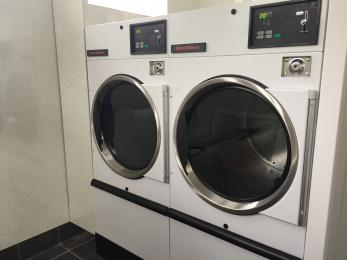 Self Catering Laundry Block showing front loading Tumble Dryers