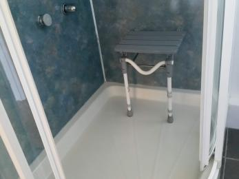The shower seat in the open position.