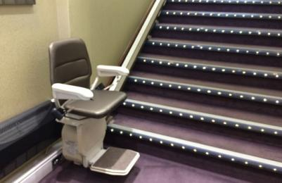 Stairlift at bottom of stairs to upper ground floor