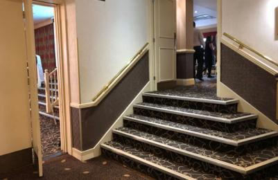 Sandown Suite entrance and stairs to bar area