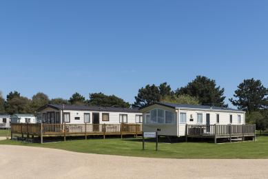 Photograph of static caravans showing space next to each for parking.