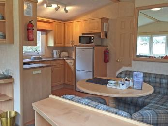 Standard 3 bedroomed caravan open plan Kitchen, all kitchen units, surfaces and worktops are of normal height
