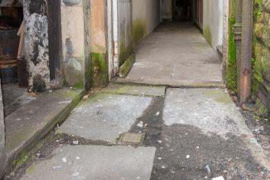 Photo of step into laundry (left of photo) and of step to corridor to kitchen (right of photo)