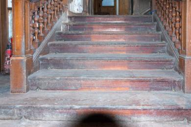 Photo of steps from Victorian extension ground floor to main hall on ground floor