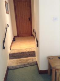 Lighting over steps in annexe 4 and two handrails.