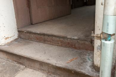 Photo of steps from lower ground floor corridor to ground floor of Victorian extension