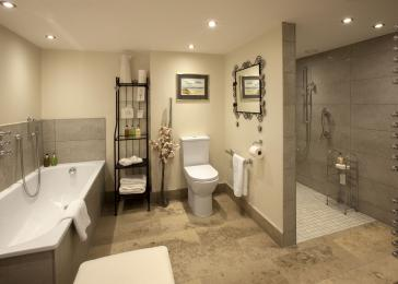 The Bathroom in The Carriage House includes Grabs and  a wetroom with wheel-in access