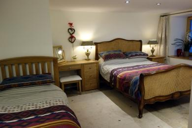 The bedroom in The Carriage House is spacious and flexible