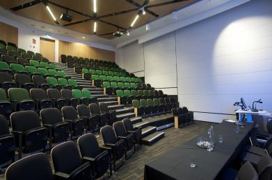 Auditorium B has fixed, tiered seating with two wheelchair spaces in the front row.