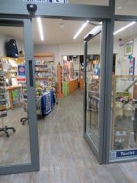 Tourist Information Centre doorway showing shop on left hand side of entrance