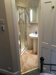 Thistle room en suite with underfloor heating and level access from guest room