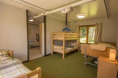 Accessible bedroom one  with one bunk bed, onesingle bed and onesingle electric profiling bed