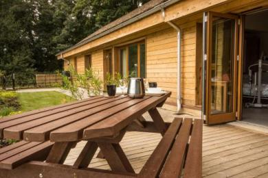 Large, level access, decked terrace with a wheelchair accessible picnic bench