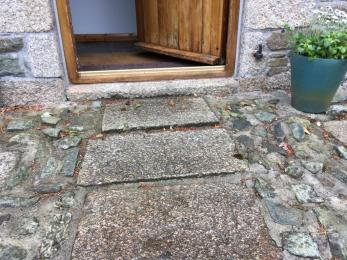 Close up view of the 3 shallow steps to the main entrance of Stable Cottage