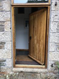 The front door for Stable Cottages with 3 shallow steps