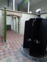 Interior of Victorian mens toilets showing tiled floor and urinal