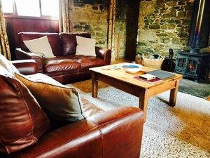 View of sofas and wood burner