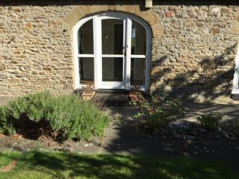 The doorway from the courtyard to the corridor of Wear View Cottage, a wooden removable ramp is available for this 240 mm step