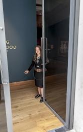 A team member holding open one of the gallery doors - the team are always happy to help.
