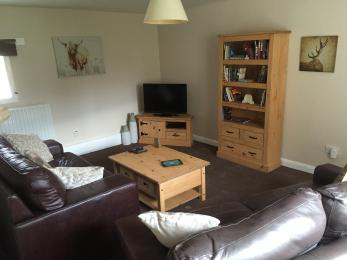 The lounge in Witton View Cottage