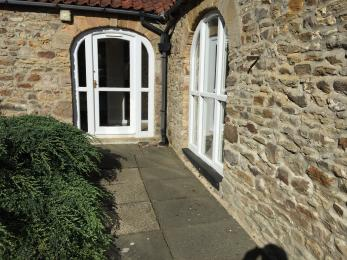 Witton View Cottage doorway to the courtyard is 750 mm wide and has a step 150 mm high.