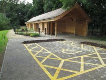 Large accessible parking space next to The Woodlands