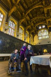 Visitors in the Great Hall using the audio guides