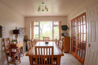Dining room towards back garden with double doors to lounge on right