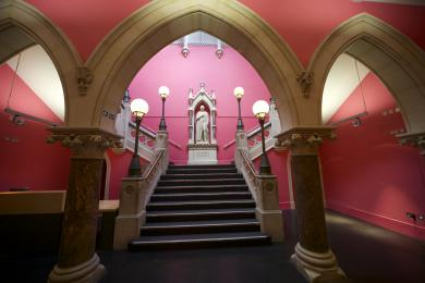 A photograph of the staircase leading from the Queen Street Entrance to the first floor.