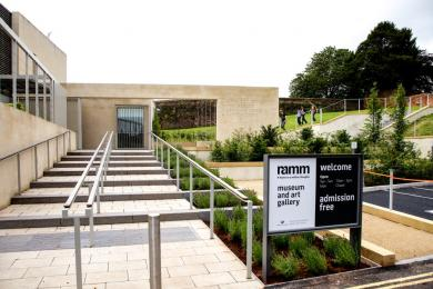 A photograph of the stairs from the blue-badge bays to the Garden Entrance