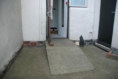 apartment 1A back door entrance with ramp 1000mm long,, 910 wide, 230 high, platform 920 x685 door w 695