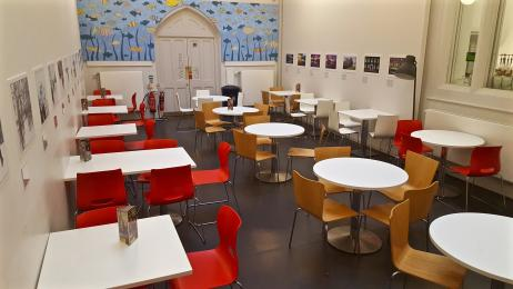 A photograph of the Cafe at RAMM's additional seating area and doors leading out to the Queen Street reception.