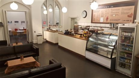 A photograph of the Cafe's serving area taken from the Courtyard entrance.