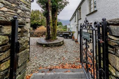 Stone steps down to Campbell Cottage Main Entrance