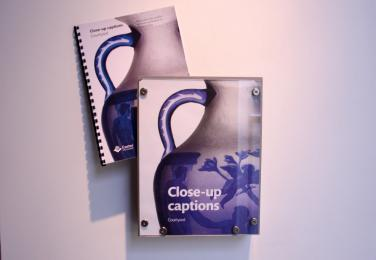A photograph of the close-up caption booklets located in all galleries.