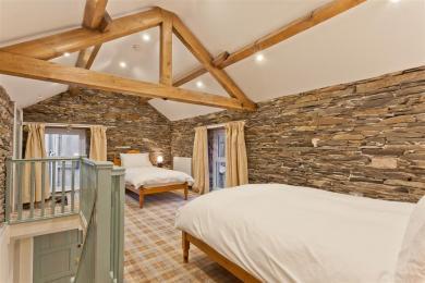 Bedroom showing low beam