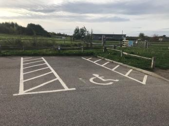 3 marked disabled parking spaces located closest to the cafe buildiing.