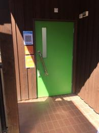 Green external door  showing flat entrance
