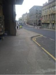 Image of drop off point outside the GFT. There is no drop kerb.