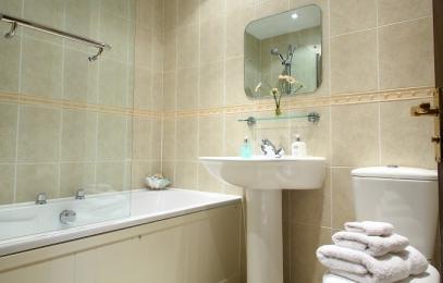 family bathroom with power shower over bath