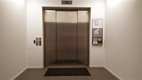 A photograph of the lift located next to the Garden Reception which operates between all floors: pictured at the ground floor.