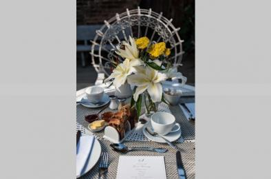 Breakfast table set up for alfresco dining