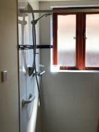 The shower at the Vine House has a grab rail and a hand held shower head to make showering easy.