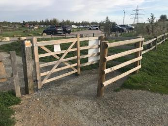 Wheelchair accessible kissing gates at entrance to trails from car park.